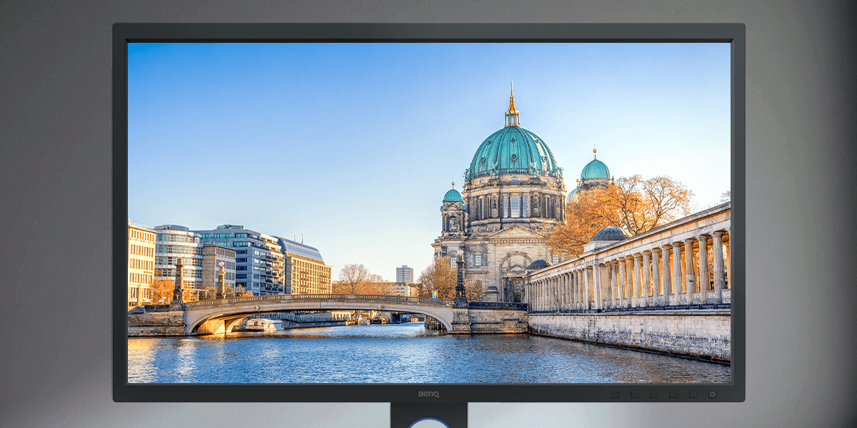 Matte monitor screen shows a European cathedral chruch by a river